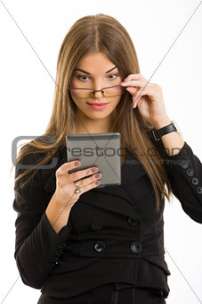 Beautiful woman using ebook reader