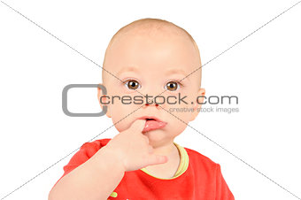 Baby boyin red shirt  sucking on his finger