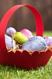 Red basket with Chocolate Easter eggs 