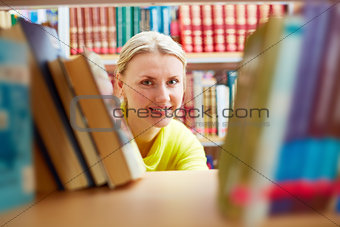 Peeking out of books
