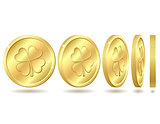 Set of golden coins with four leaf clover.