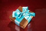 gift on red sparkling background