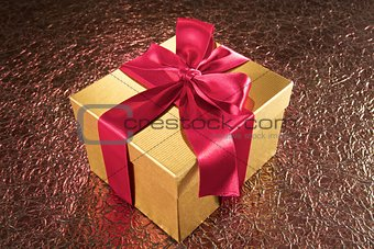 golden gift on sparkling background