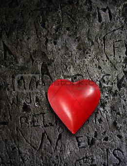 Metal heart on grunge wall
