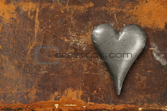Metal heart on grunge background