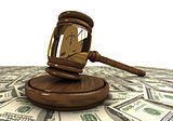 Judge's gavel standing on a dollars