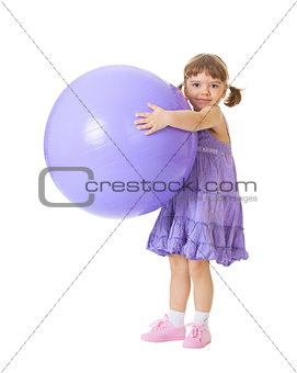Little girl with a big purple ball