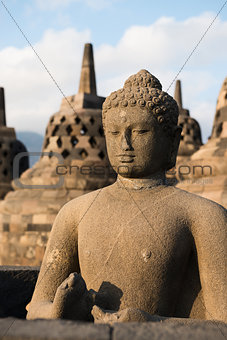 Buggha statue and stupas in Borobudur temple, Indonesia