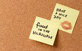 Yellow sticky note/ post it Have a nice day. Kiss food in the microwave