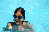Teen girl in swimming pool portrait