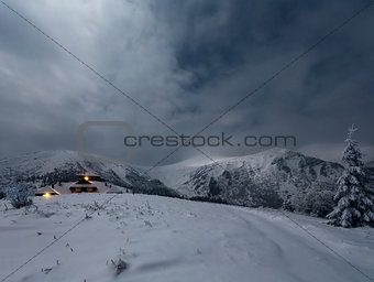 Night winter mountain landscape with house.