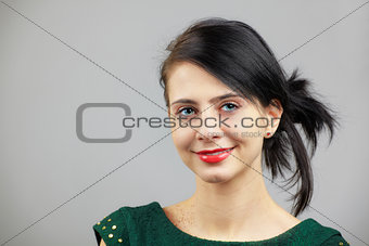 Woman portrait over grey
