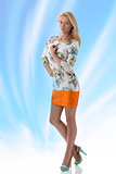 blonde girl clothing dress with floral pattern had hand on the b
