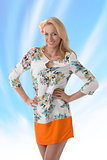 blonde clothing dress with floral pattern she smiles