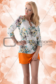 blonde clothing dress with floral pattern and hand on the hip