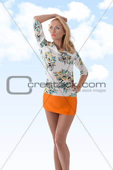 blonde clothing dress with floral pattern looks at right