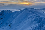 sunset over the mountains in winter