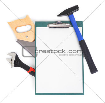 Work tools and clipboard on white