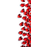 red glass hearts on white background