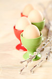 Eggs in red and green eggcups