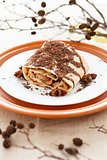 Apple pie strewn grated chocolate and decorated of dry branch