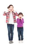 two beautiful asian little girls shouting together