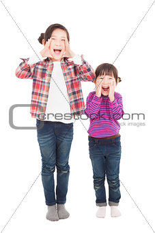 two beautiful asian little girls shouting together