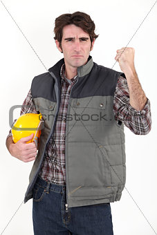 Angry builder waving fist