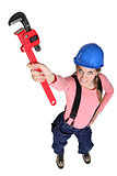 Women holding a wrench