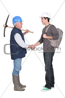 Apprentice shaking hands