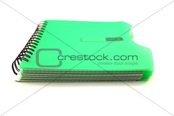 green notebook on white background