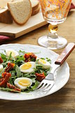 salad with sun dried tomato and quail eggs
