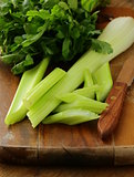 fresh chopped celery on a cutting board