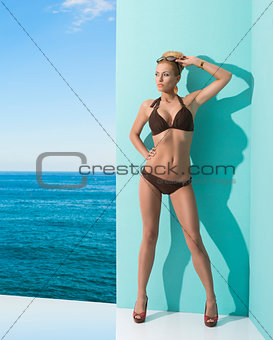 woman in bikini with sunglasses on the head