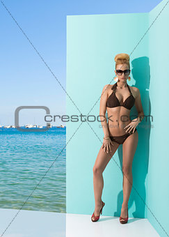 woman in bikini with sunglasses and hand on the hip