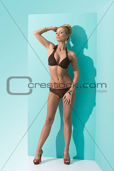 woman in bikini with sunglasses in front of the camera