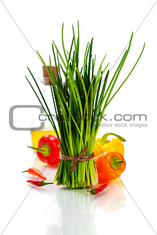 A bunch of fresh chives and vegetables