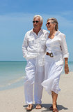 Happy Senior Couple Walking by Sea on Tropical Beach