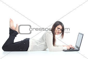 Beautiful woman lying with a laptop