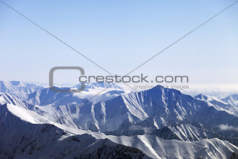 Snowy mountains in haze