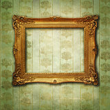 Empty golden feame on a green vintage texture