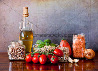 Legumes and vegetables on the kitchen table