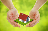 Hands brings small house outdoor