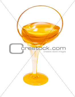 honey flow dropping from glass cup isolated on white
