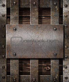 aged metal plate on wooden medieval background