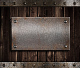 metal plate  on old wooden wall or door