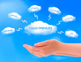 Cloud computing concept. Hands with blue sky and white cloud.