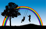 Kids playing under rainbow