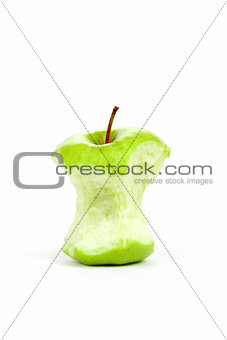 Green bitten apple isolated on white