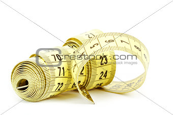 Yellow measuring tape isolated on white